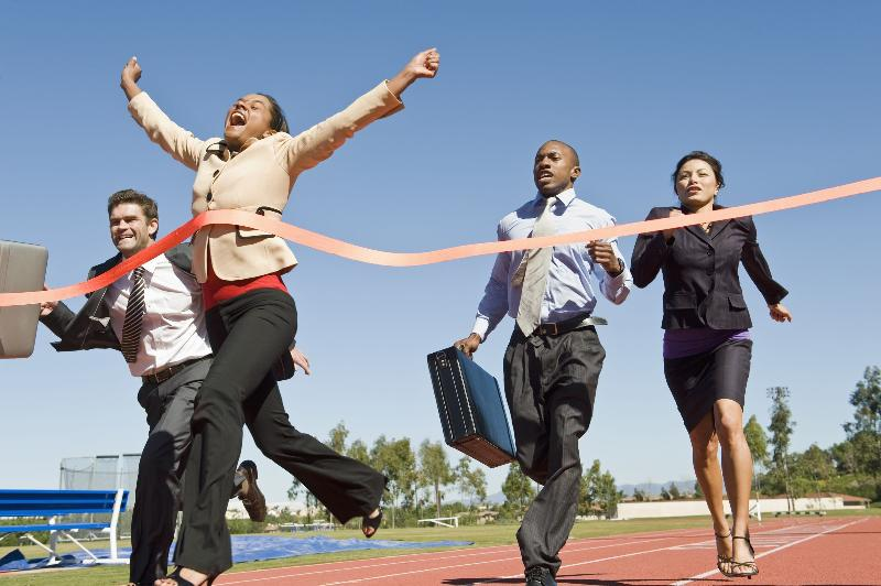 business-lady-crossing-finish-line